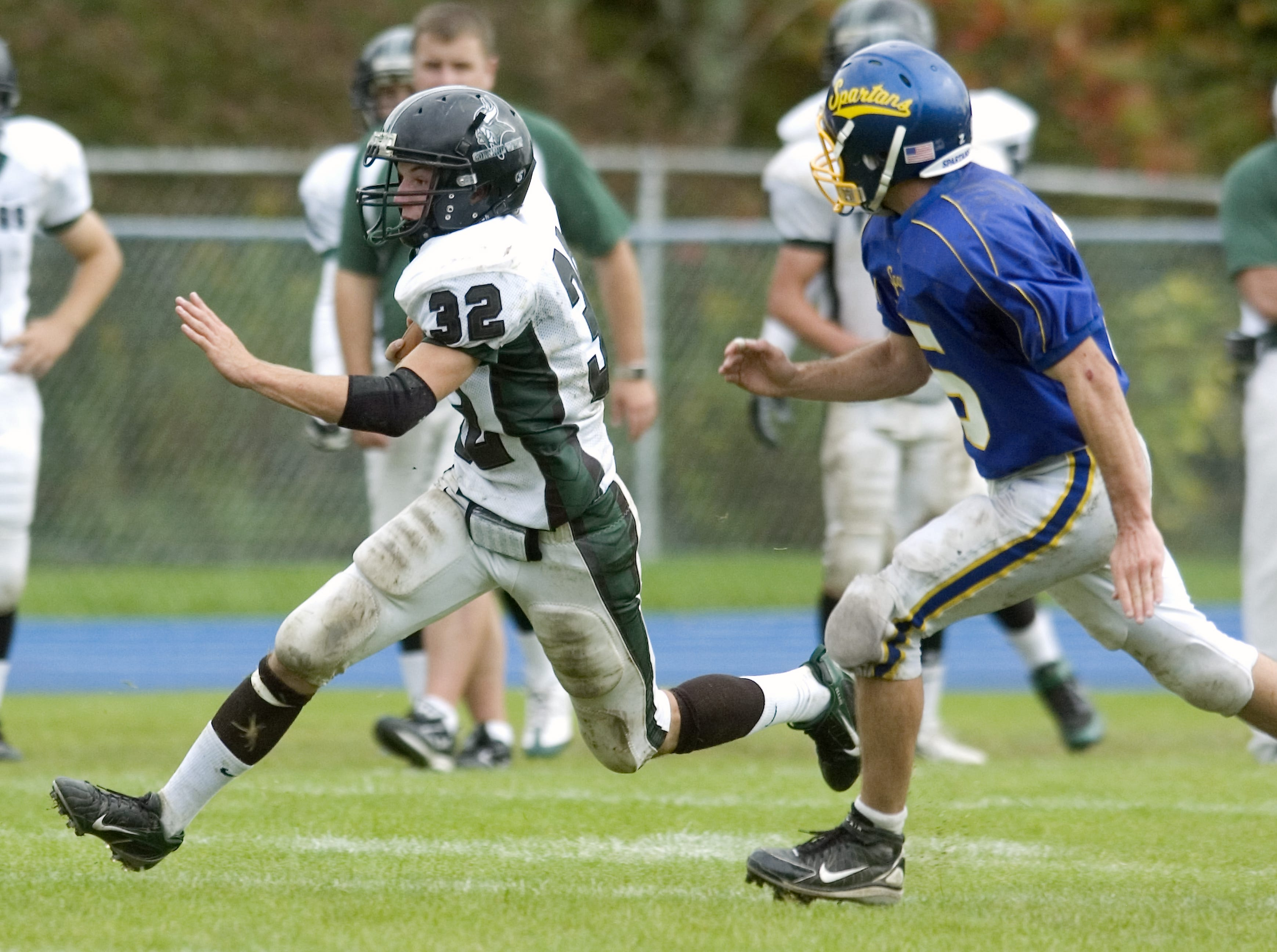 Corning West's Gregory Riff, left, takes the ball past Maine-Endwell's Joey Powell in the third quarter of a 2008 game at M-E.