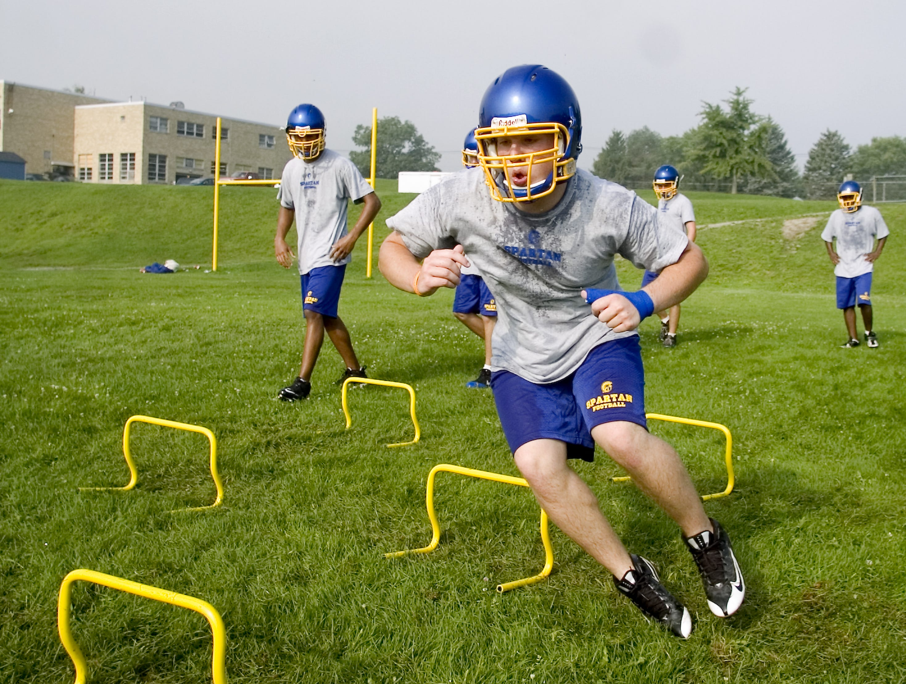 Senior Nate Reynolds runs a sprint drill in 2009 during the first day of football practice at Maine-Endwell High School in Endwell.