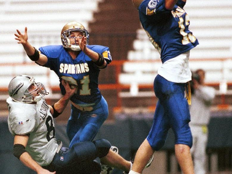 In 1998, Maine-Endwell's Ryan Carney (13) intercepts a pass at the second the half time buzzer sounds in a 0 to 0 game as Lackawanna's Robert Sireika (88) and Maine-Endwell's Matt Schieffen (21) watch the play.