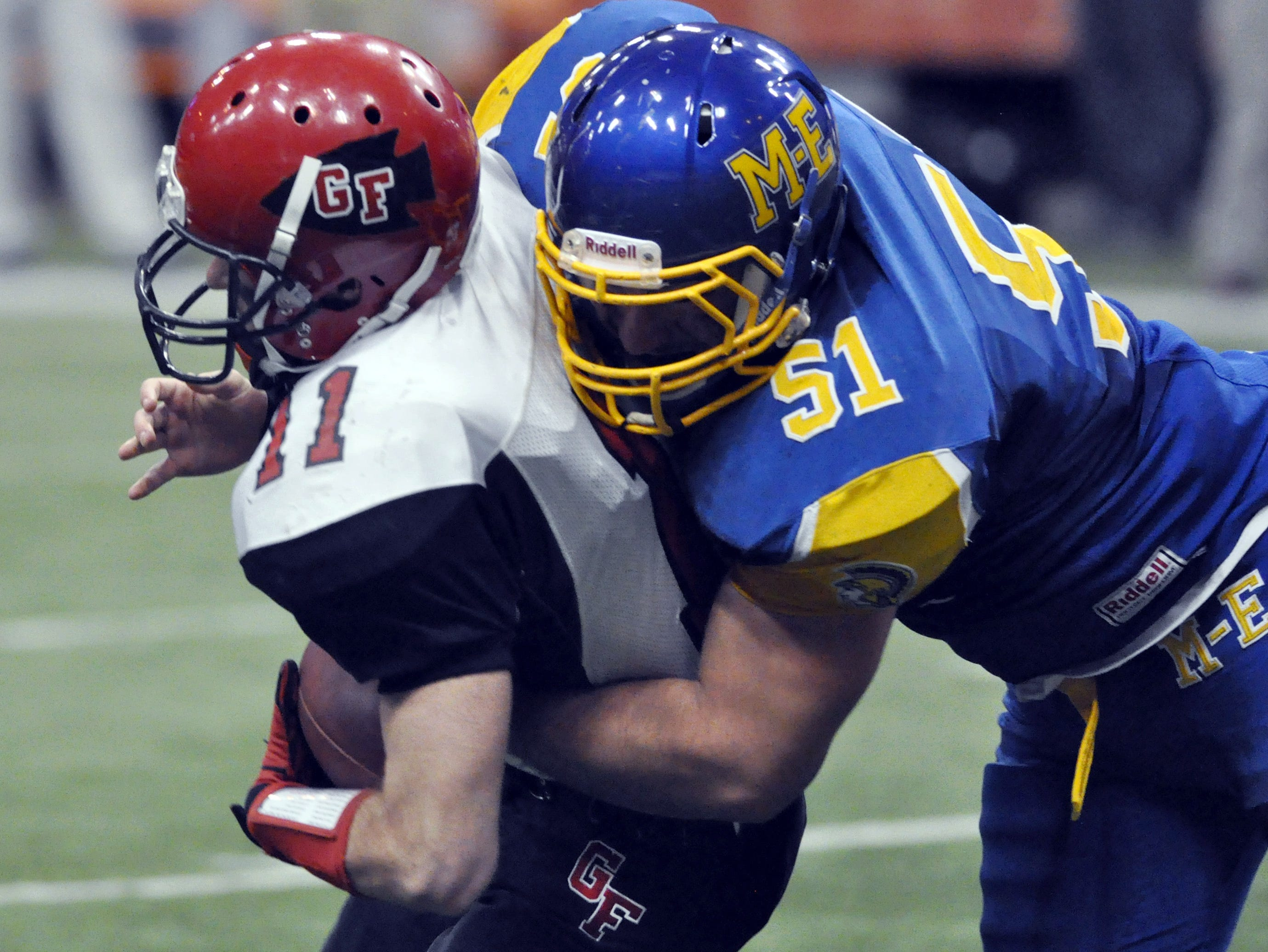 Maine-Endwell's Jake Haddock sacks Glens Falls quarterback Cam Girard during the third quarter of the Class B state championship game Nov. 24, 2012.