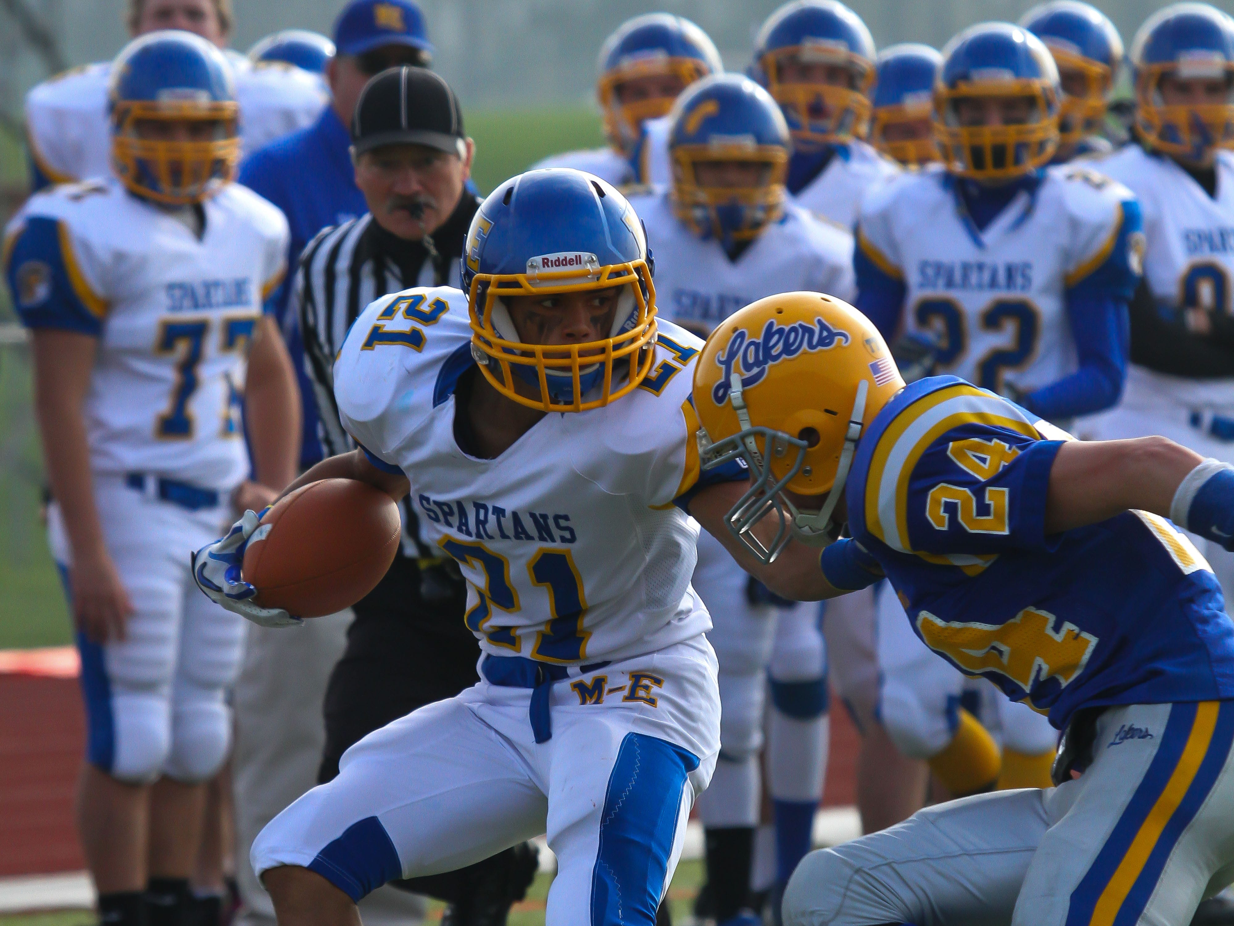 Maine-Endwell's Luis Uceta is run out of bounds by Cazenovia's Joe Colligan on in 2012 at East Syracuse-Minoa High School.