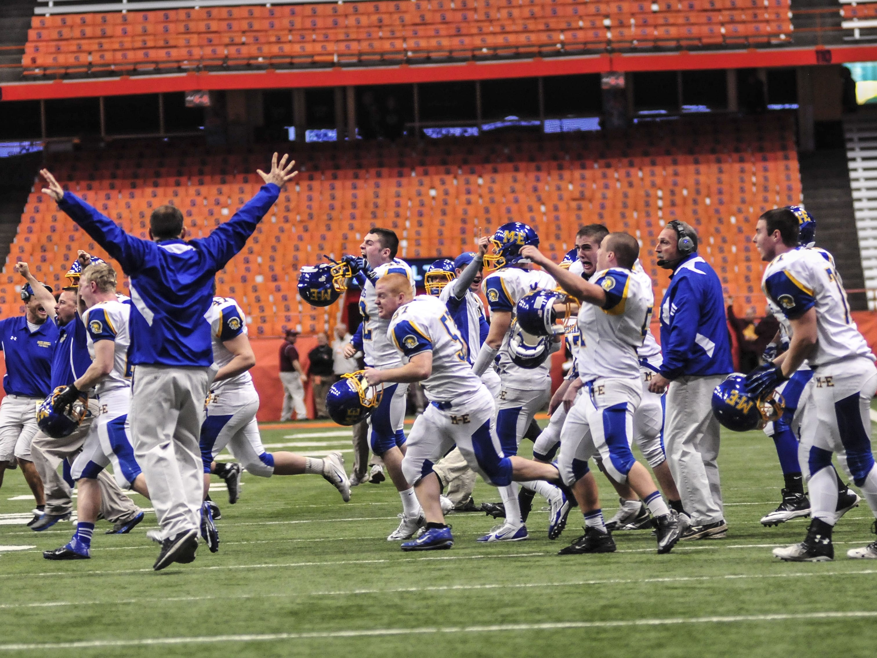 Members of the Maine-Endwell football team charges the field after a two-point conversion late in the fourth quarter against Schalmont during the 2013 New York State Public High School Athletic Association Football Class B Championship at the Carrier Dome.