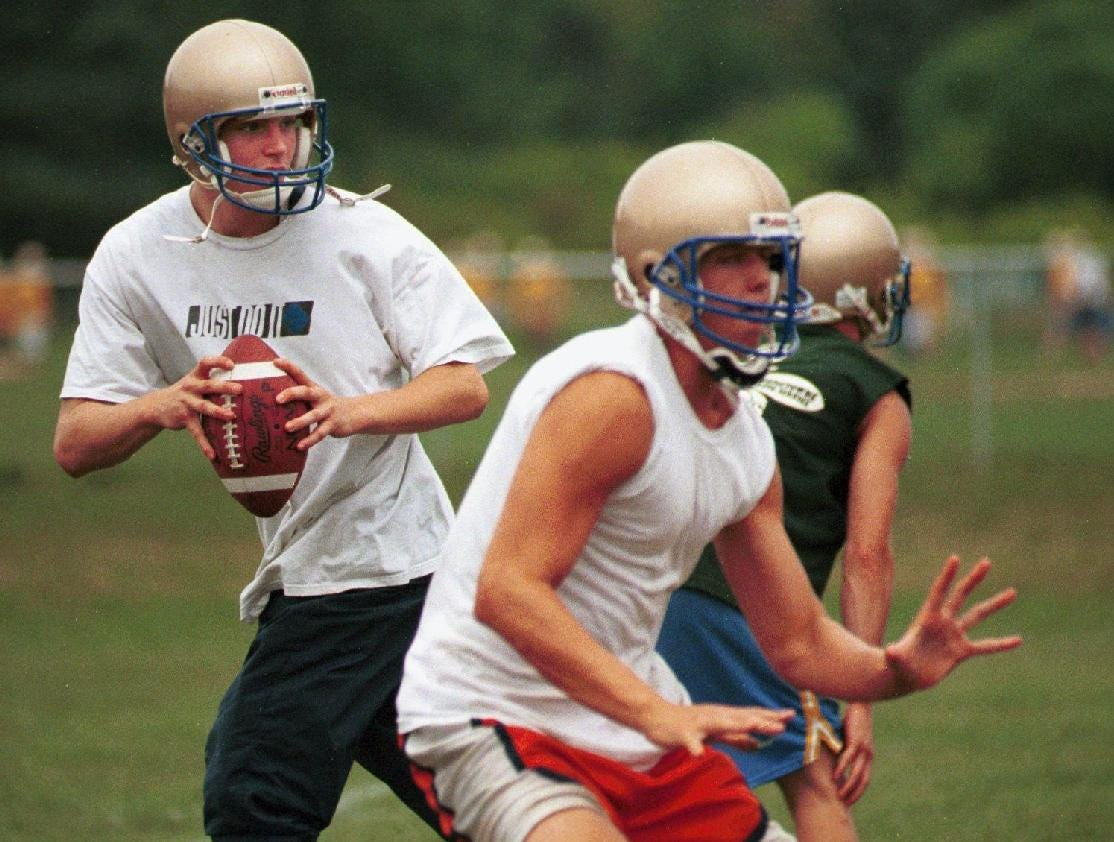 In 1998, Maine-Endwell quarterback Ryan Carney, 17, drops back during a practice at M-E High School.