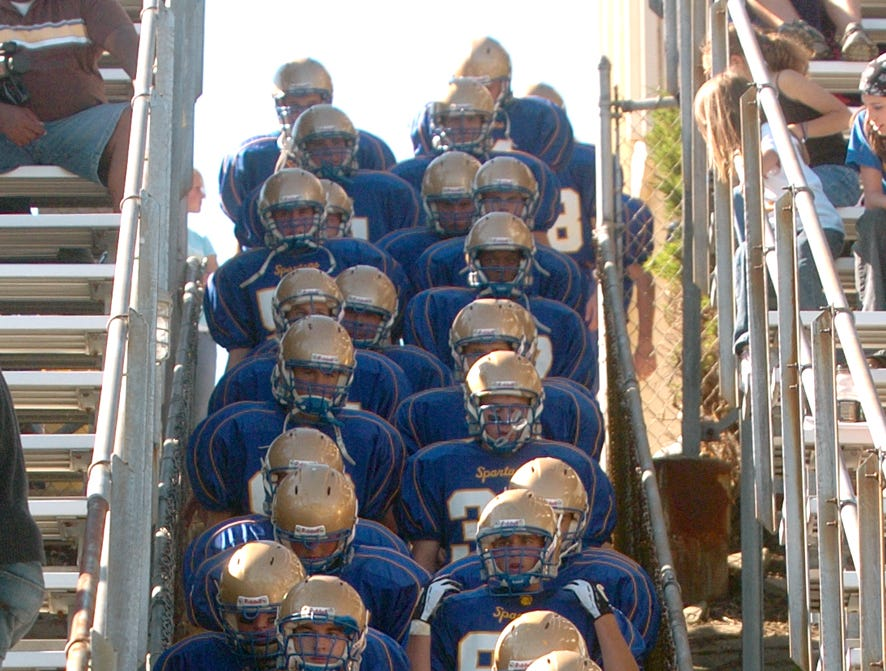 The Maine-Endwell High School football team makes its way to the field for the second half of their 2005 homecoming game.