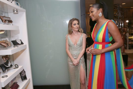 LOS ANGELES, CA - SEPTEMBER 17:  Tiffany Haddish (R) attends Backstage Creations Giving Suite supporting Television Academy Foundation At The 70th Emmy Awards at Microsoft Theater on September 17, 2018 in Los Angeles, California.