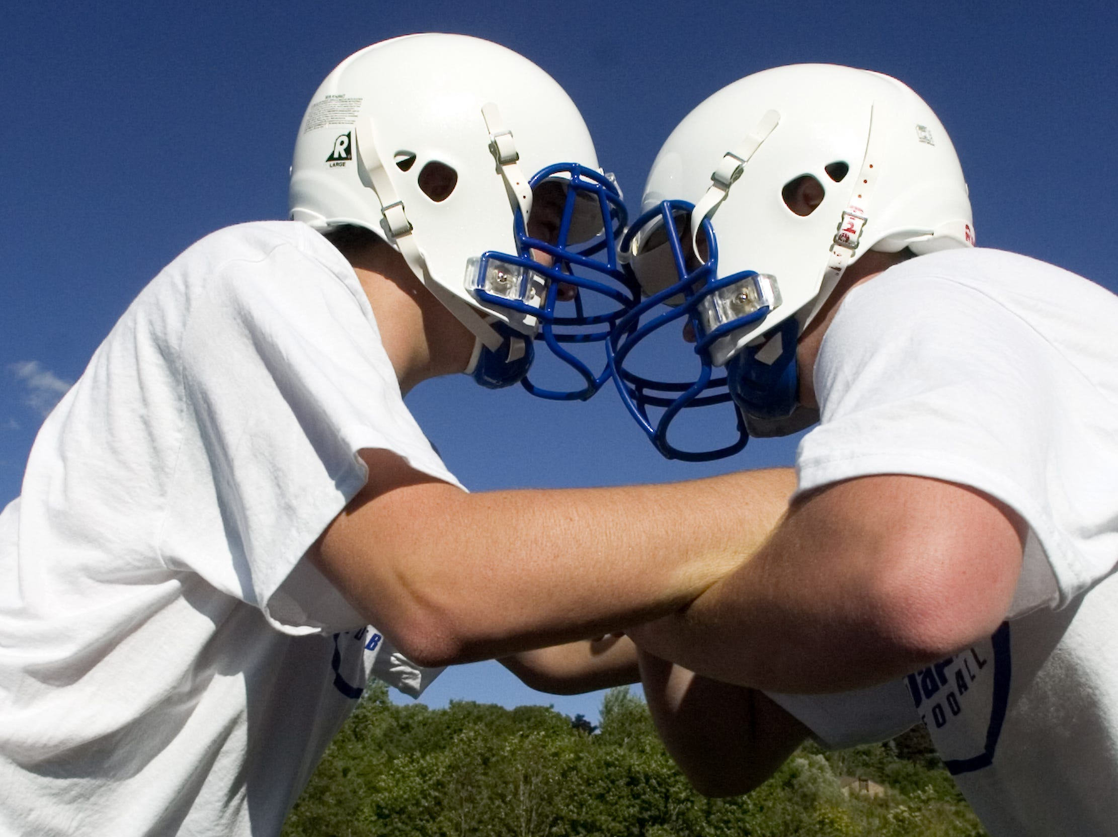 Sophomore Ross Scribner, right, and junior Tyler Kelly run through a defensive drill during the first day of Maine-Endwell High School's football practice Monday in Endwell in 2005.