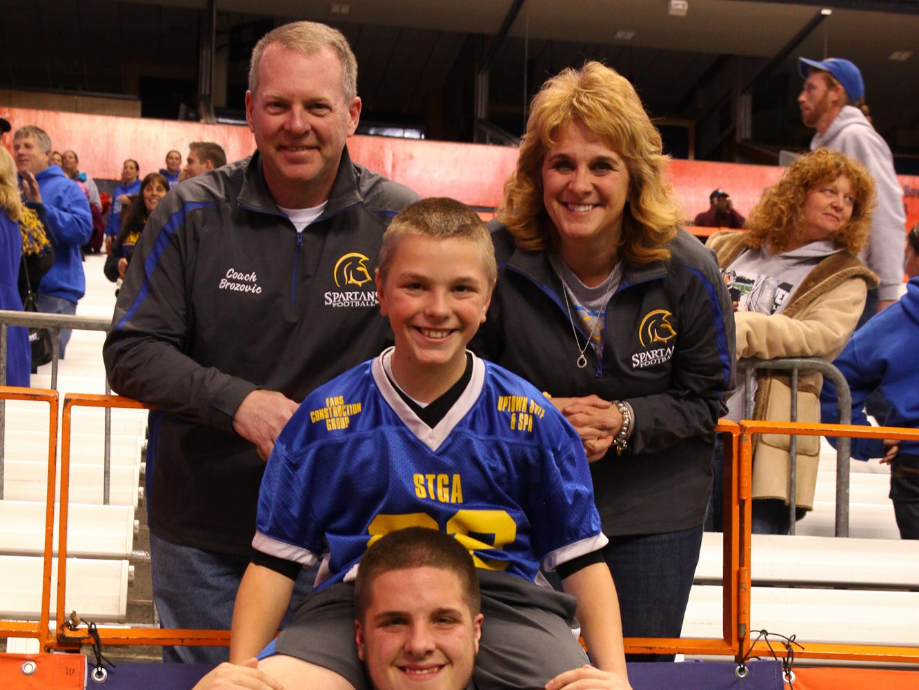 Matthew Brozovic, #50, with his brother, Ryan, and parents, Matt and Theresa, after Maine-Endwell's 2013 state title victory at the Carrier Dome in Syracuse.