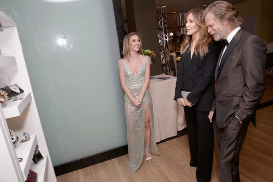 LOS ANGELES, CA - SEPTEMBER 17:  Felicity Huffman (C) and William H. Macy attend Backstage Creations Giving Suite supporting Television Academy Foundation At The 70th Emmy Awards at Microsoft Theater on September 17, 2018 in Los Angeles, California.