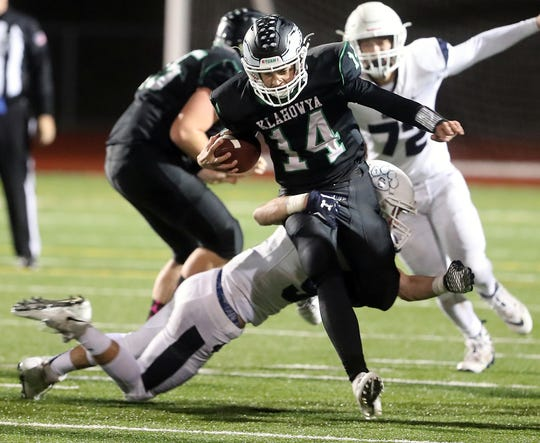 Cascade Christian's Eli Thorsteinson wraps up Klahowya's John Hartford as he carried the ball down the field at Silverdale Stadium on Thursday, October 25, 2018.