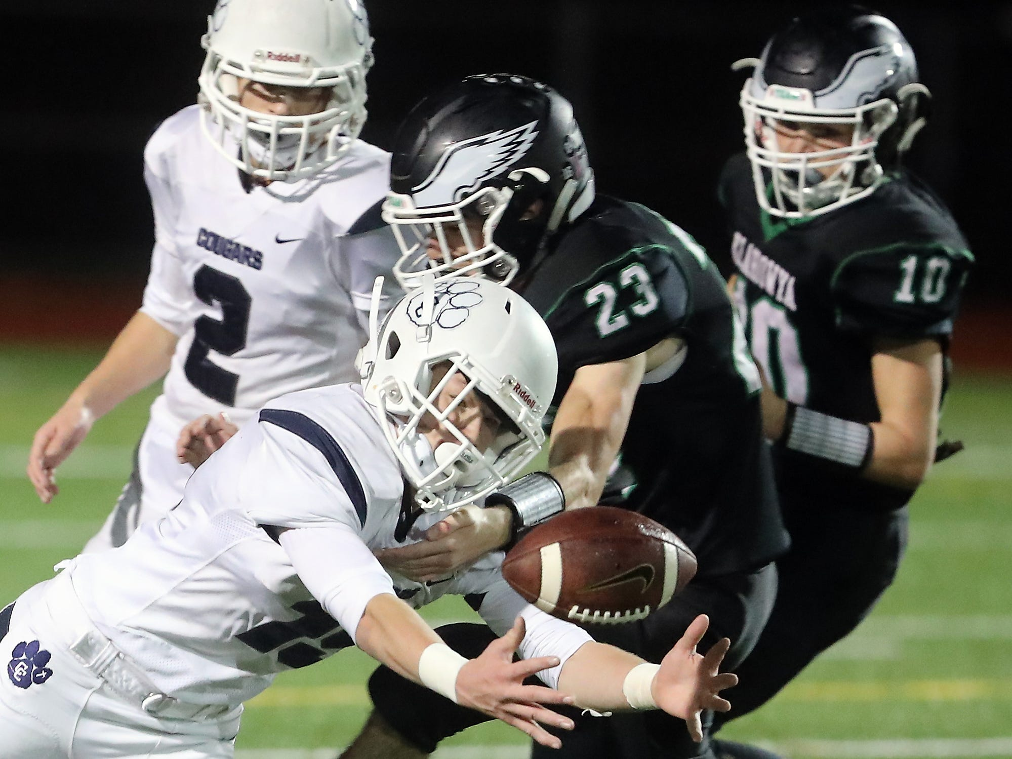 Cascade Christian's Connor Zetterberg (15) makes a grab for a loose ball while under the pressure of Klahowya's Nicholas Lewis (23) at Silverdale Stadium on Thursday, October 25, 2018.