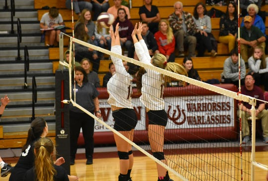 Shelby Ballard (left) and Chesney Gardner go up for a block during a first-round playoff game.