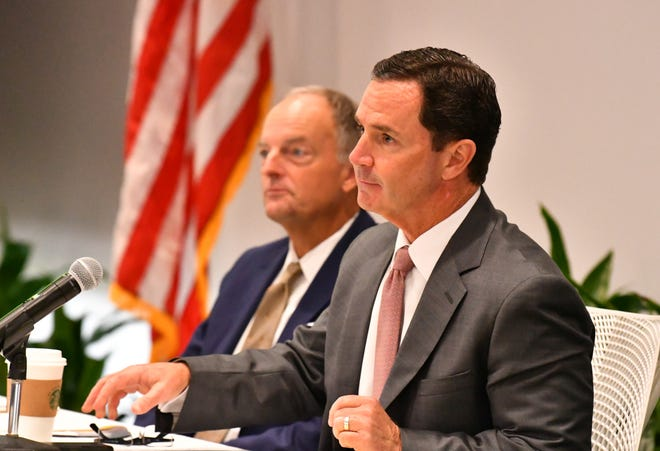 Harris Chairman, President and CEO Bill Brown (foreground) and Scott Mikuen, senior vice president and chief  legal council at the Harris Corp. annual stock holder's meeting Friday afternoon.