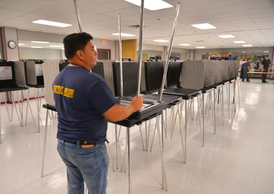 Workers from the Brevard County Supervisor of Elections Office prepare the early voting site at the Tony Rosa Palm Bay Community Center on Port Malabar Boulevard.