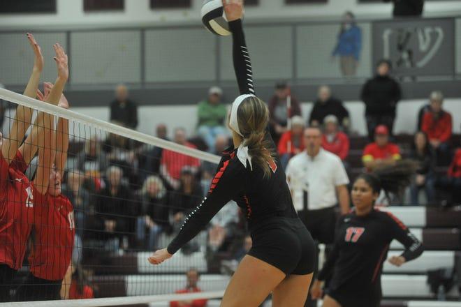 Crestview's Natalie Restille spikes a ball at the net.