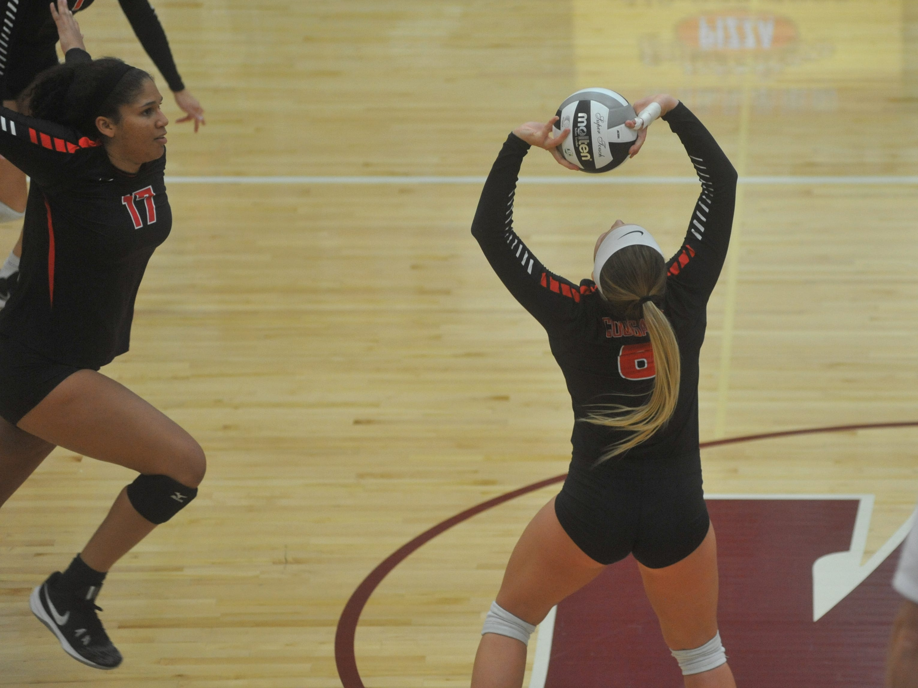 Crestview's Magey Shambrae sets Kyla Brafford at the net.