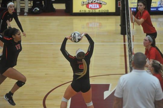 Crestview's Magey Shambrae sets Kyla Brafford at the net.