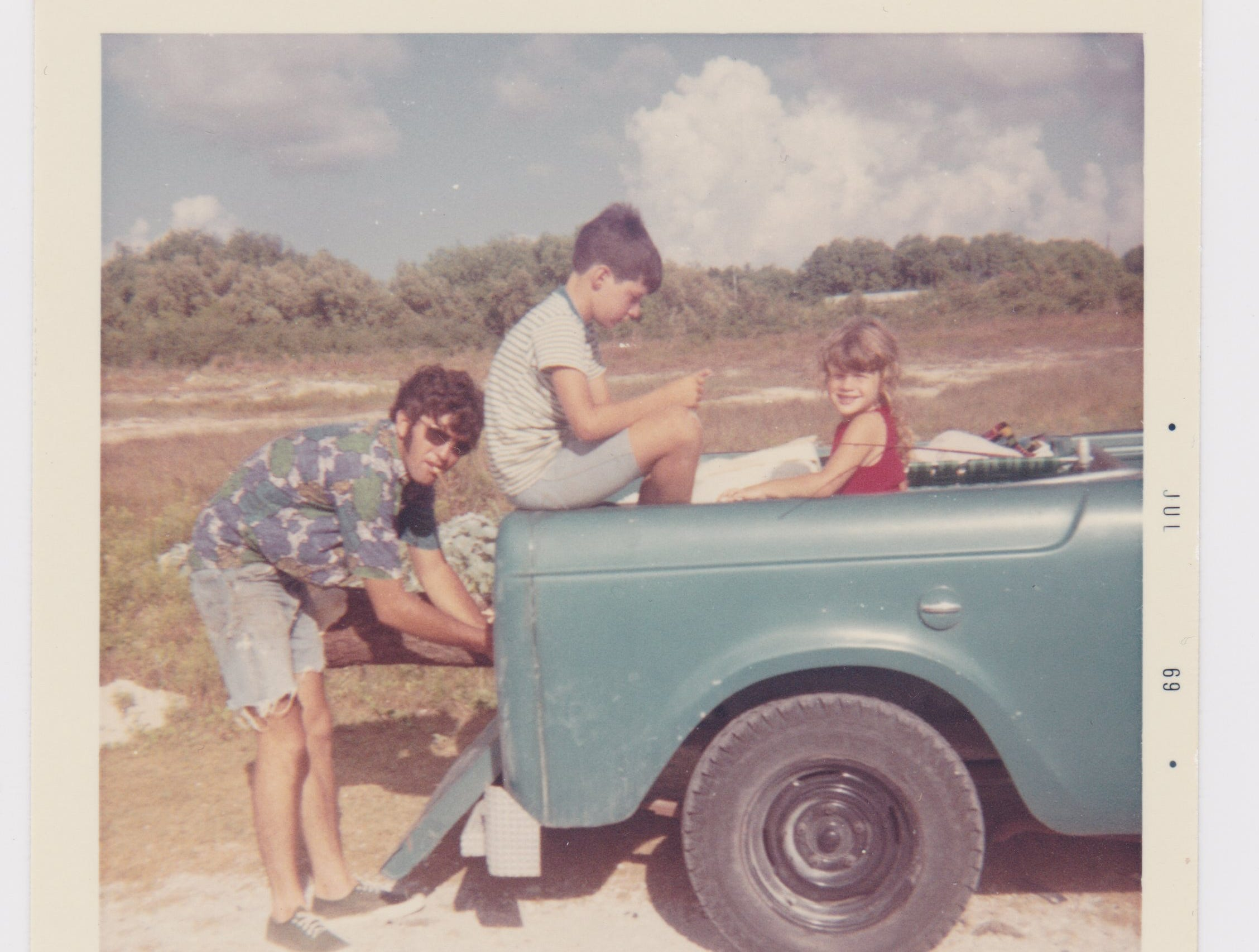 Tony Joe White (left) often spent time on Padre Island fishing and boating when not performing his signature brand of swamp rock at nightclubs in Corpus Christi and Kingsville. Pictured in the back of the pickup are his oldest son Jim Bob and daughter Michelle.