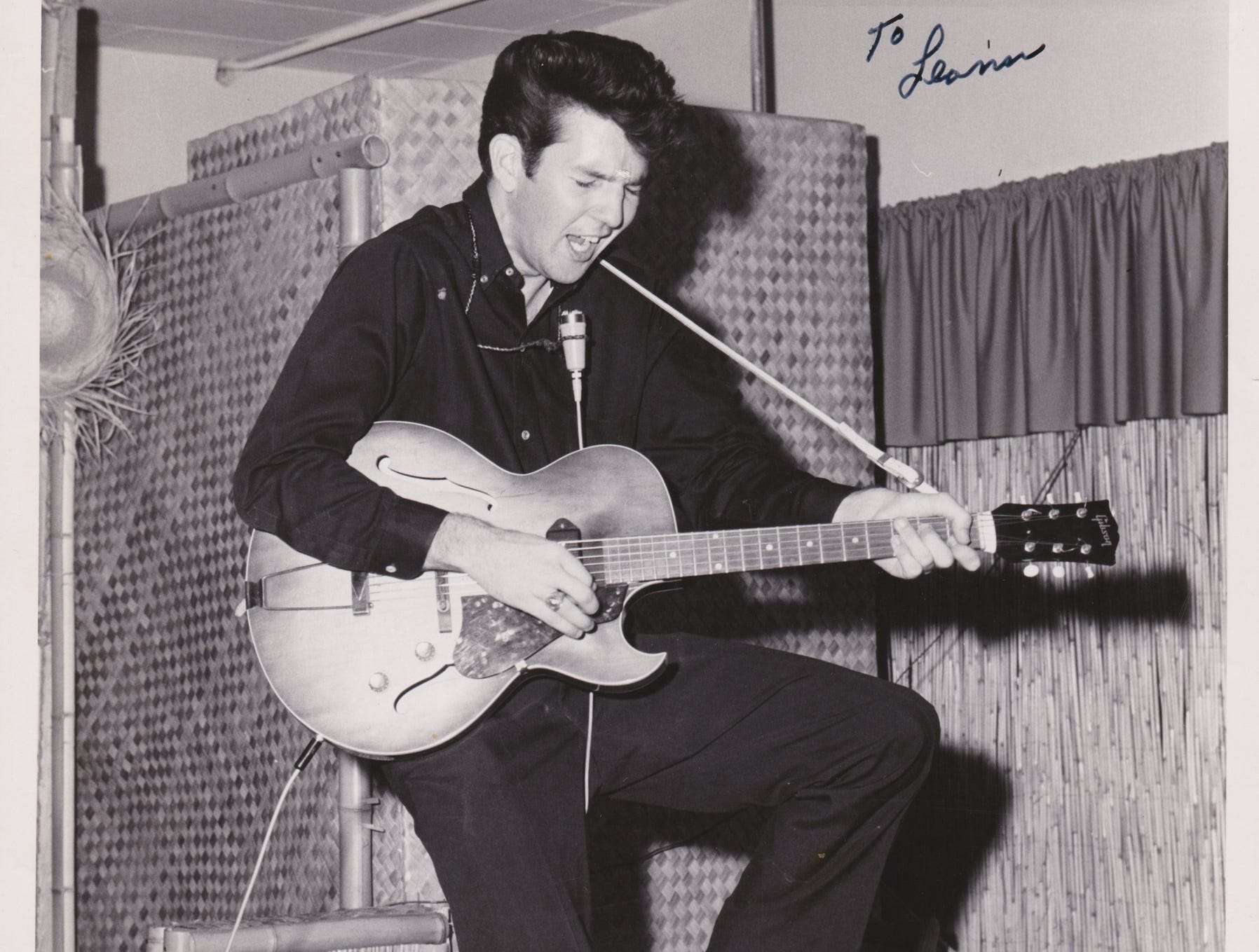 """Musician Tony Joe White provided this photo of himself performing at a club in Kingsville. While memories are fuzzy, White believes this photo was taken at the Beachcomber's Club. Note the photo's inscription, """"To Leann. I'll love you forever. Tony."""" Leann is White's wife."""