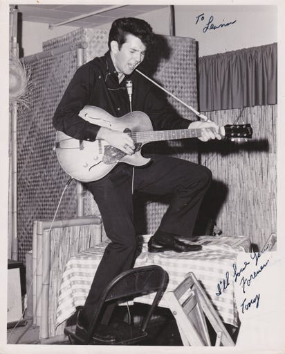 "Musician Tony Joe White provided this photo of himself performing at a club in Kingsville. While memories are fuzzy, White believes this photo was taken at the Beachcomber's Club. Note the photo's inscription, ""To Leann. I'll love you forever. Tony."" Leann is White's wife."