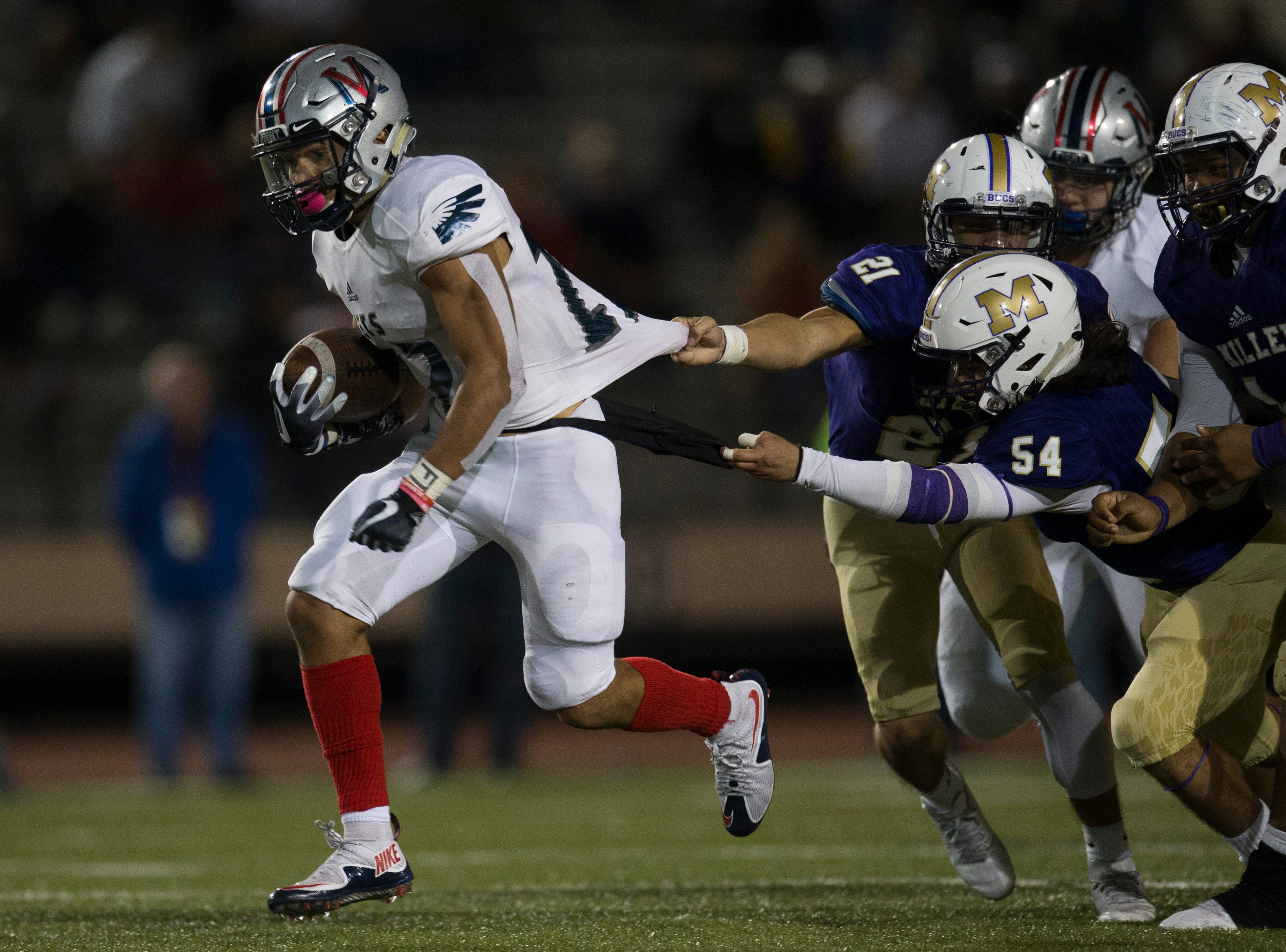 Veterans Memorial's Sethe Solis rushes past Miller defenders  during their game on Thursday, Oct. 25, 2018 at the Buccaneer Stadium.