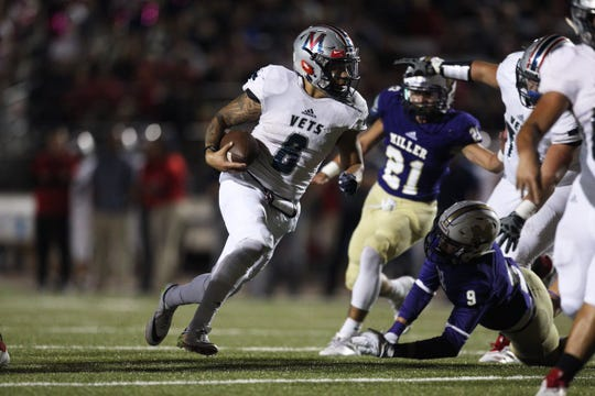 Veterans Memorial's David Soto rushes past Miller defenders  during their game on Thursday, Oct. 25, 2018 at the Buccaneer Stadium.