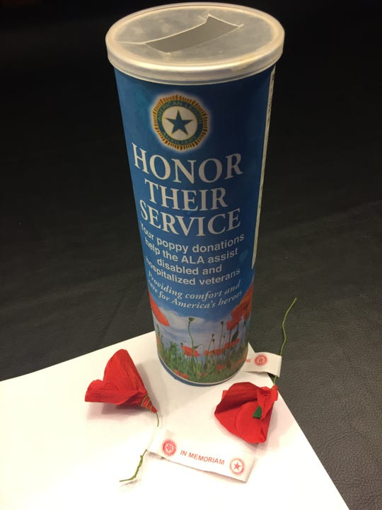 """Poppy donation can and crepe paper poppies with """"In Memoriam"""" tags used by American Legion Post 372 in Cherry Hill to raise money  around Memorial day and Veterans Day to help veterans."""