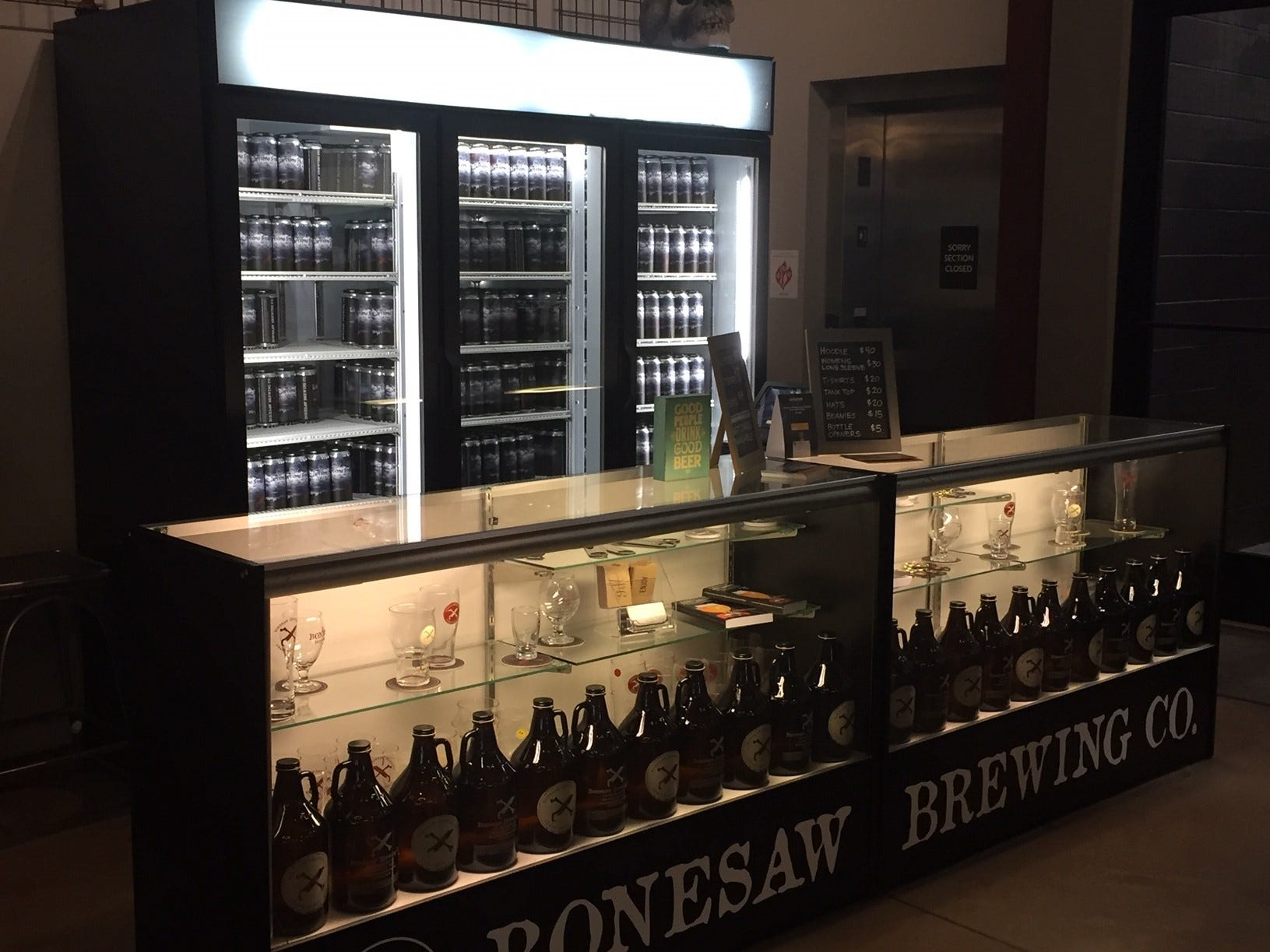 Cans, growlers, crowlers and Bonesaw Brewing Company merchandise such as glassware and T-shirts can be found in the tasting room.