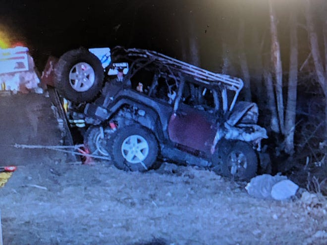A burned-out Jeep rests alongside I-295 in Mount Laurel. Two civilians and three first responders worked together to free a man from the Jeep when it was on fire in January.