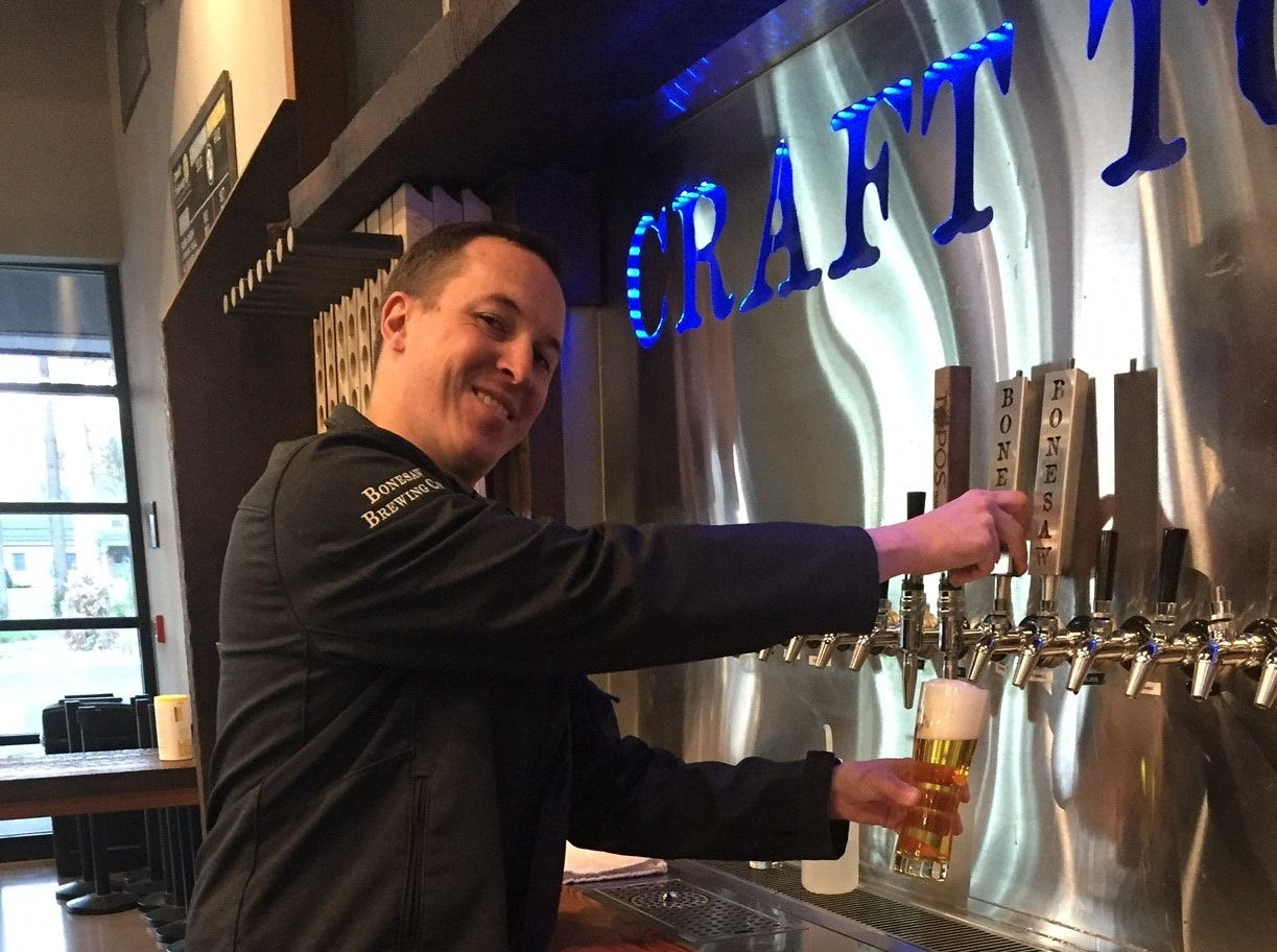 Brewmaster AJ Stoll pours a pilsner behind the tasting room bar at Bonesaw Brewing Company in Glassboro. Stoll has worked in numerous breweries and won national and international awards before coming to Bonesaw.