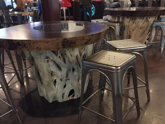A black walnut tree rotten in the core and dried fig trees came together to form the handcrafted tables at Bonesaw Brewing Company. The tables were created by Random 8 Woodworks of Pedricktown. The fig branches resemble bones.