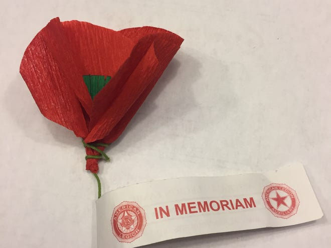 Crepe paper remembrance poppy of the American Legion emerged after World War I but continues to be given today in return for donations for needy veterans.