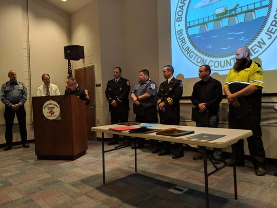 Battalion Chief Larry Fox, Virtua Paramedics Geoffrey Groff and Michael Beringer, and civilians Keith Miller and William Holshue were honored for their roles in saving a man from a fiery Jeep crash.
