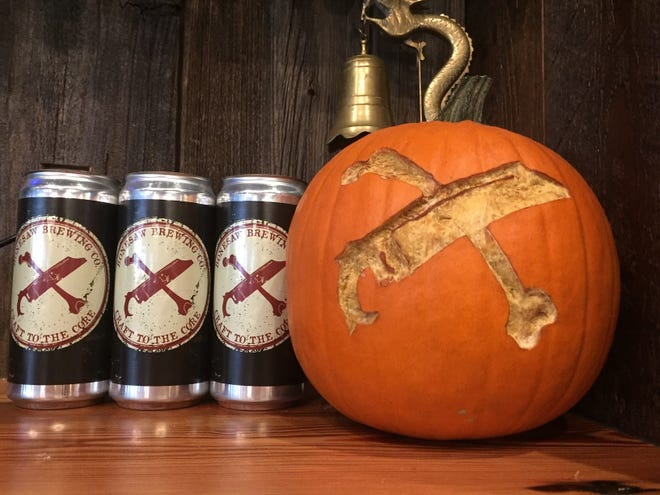 The Bonesaw logo is carved into a pumpkin at Bonesaw Brewing Company in Glassboro.