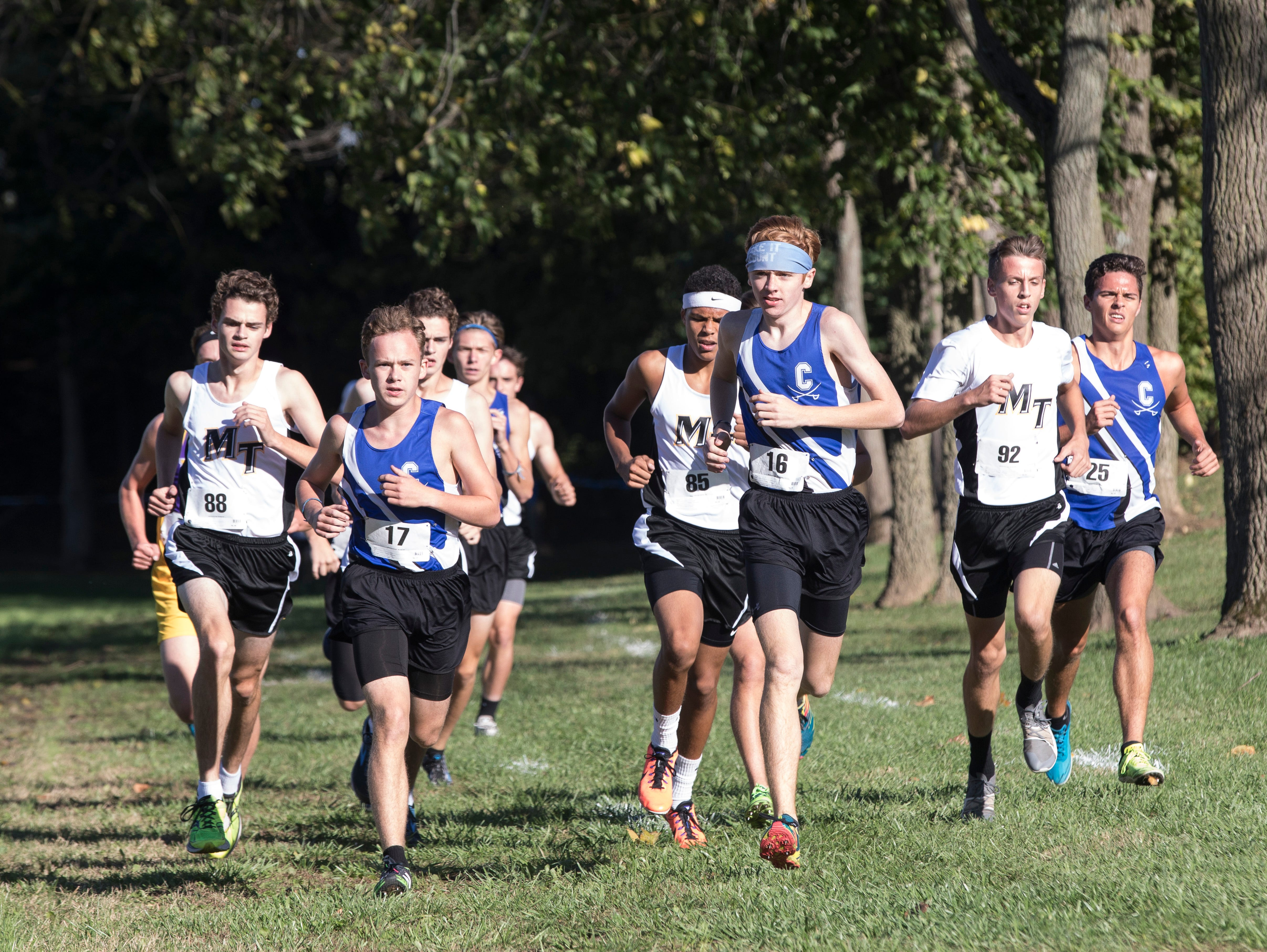 Andrew McCallum, along with fellow Chillicothe runners Ricky Villareal and Oscar Mikus, lead the pack during the first half of the 2018 Frontier Athletic Conference cross-country race.