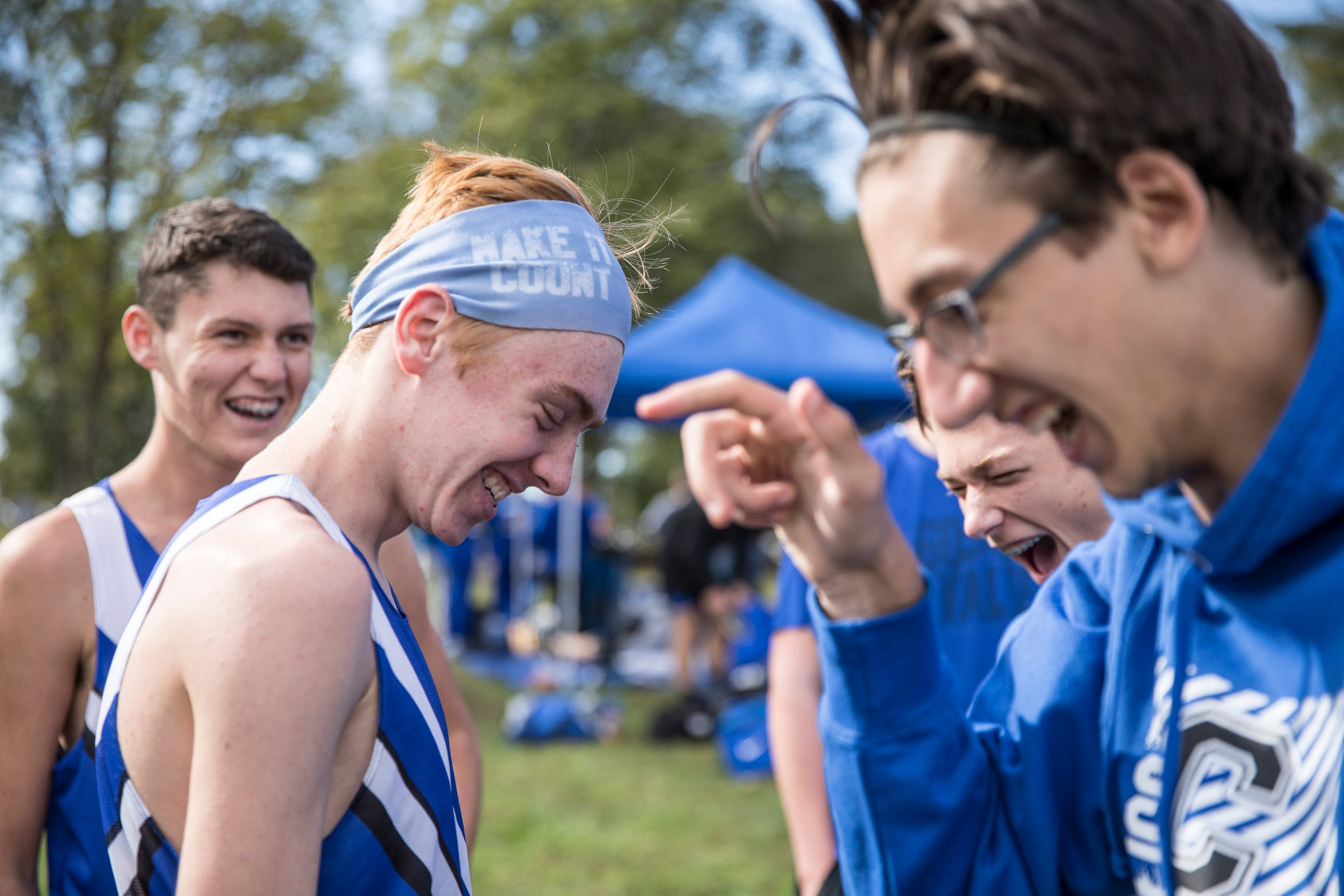 Andrew and his friends joke around to lessen the nervousness before the Frontier Athletic Conference cross country-race outside of Washington Courthouse, Ohio, on October 11, 2018.