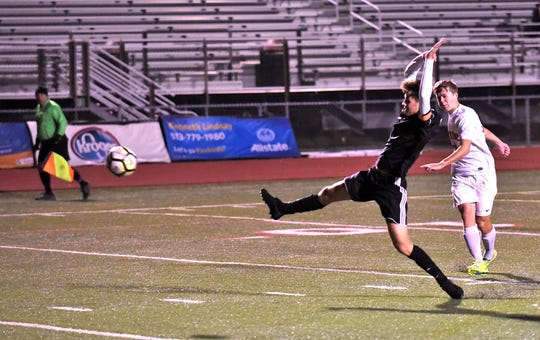 Brodie Sallows (back) powers a shot past the outstretched  Beavercreek defender and into the goal for an Anderson score as the Redskins take the SWDAB District Boys Championship, October 25, 2018