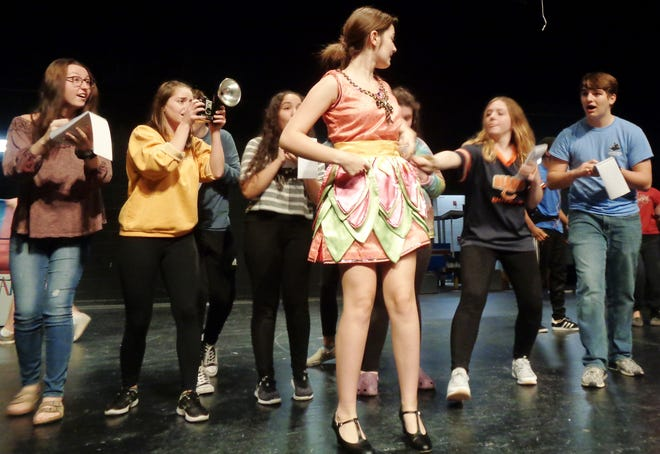 """Anna Colletto plays it up as the glamorous actress with fellow cast members during a rehearsal for the Loveland High School Nov. 7-10 production of """"The Drowsy Chaperone."""""""
