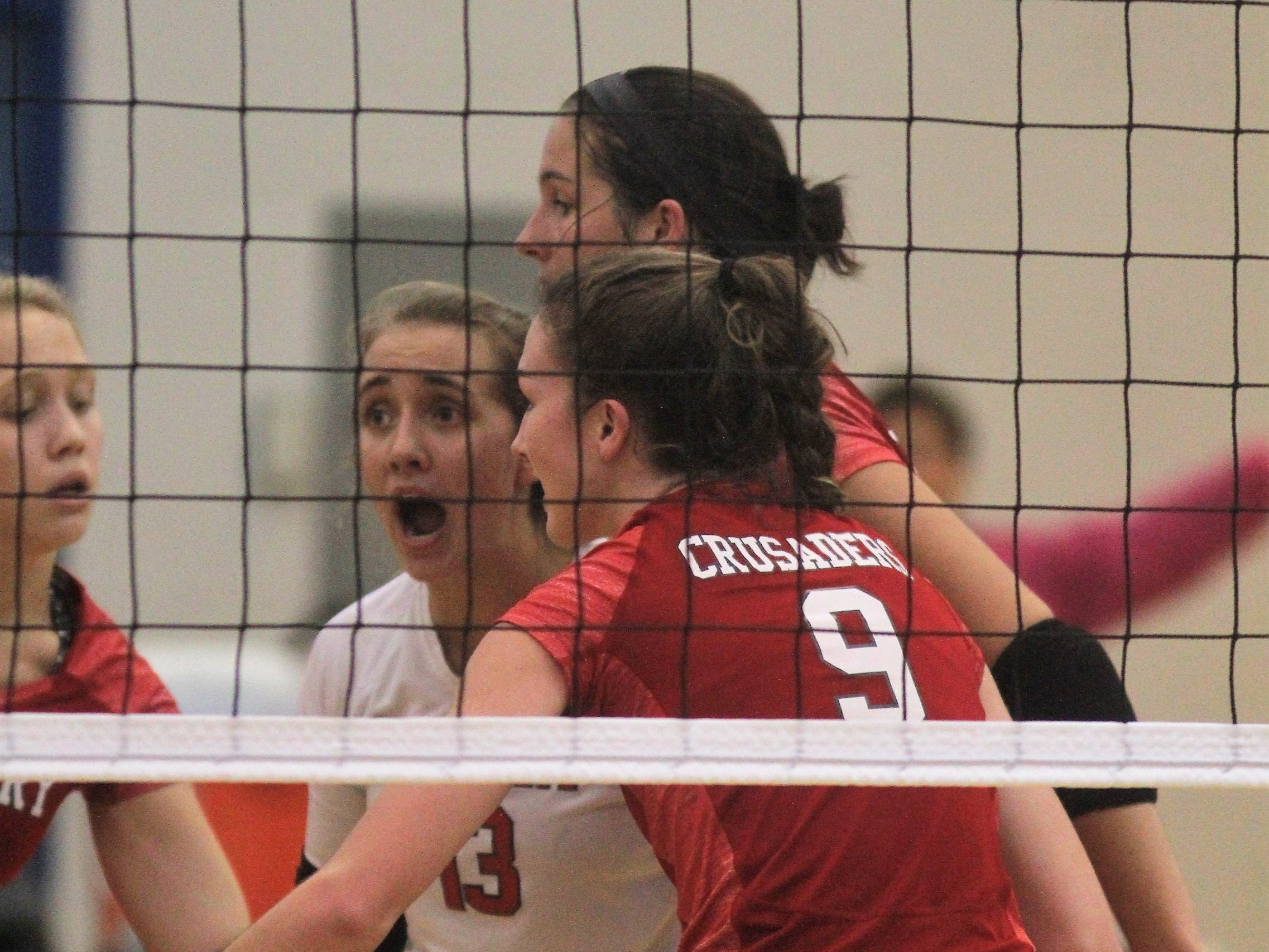 St. Henry Crusaders celebrate a point during St. Henry's 3-0 sweep of North Oldham in the first round of the KHSAA state volleyball tournament Oct. 26, 2018 at Valley High School, Louisville, KY.