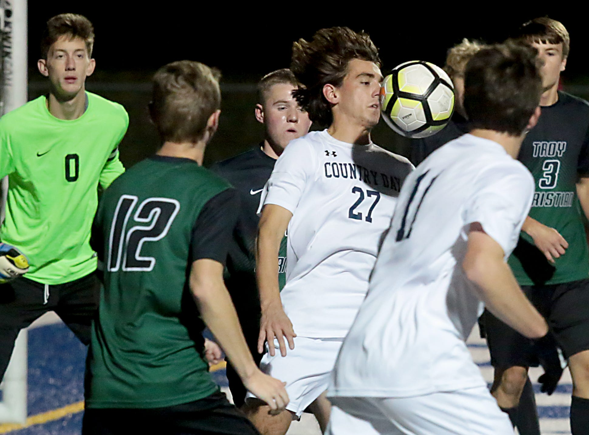 CCD midfielder Cader Rowe tries to score against Troy Christian during their Division III district final soccer match at Wyoming Thursday, Oct. 25, 2018.