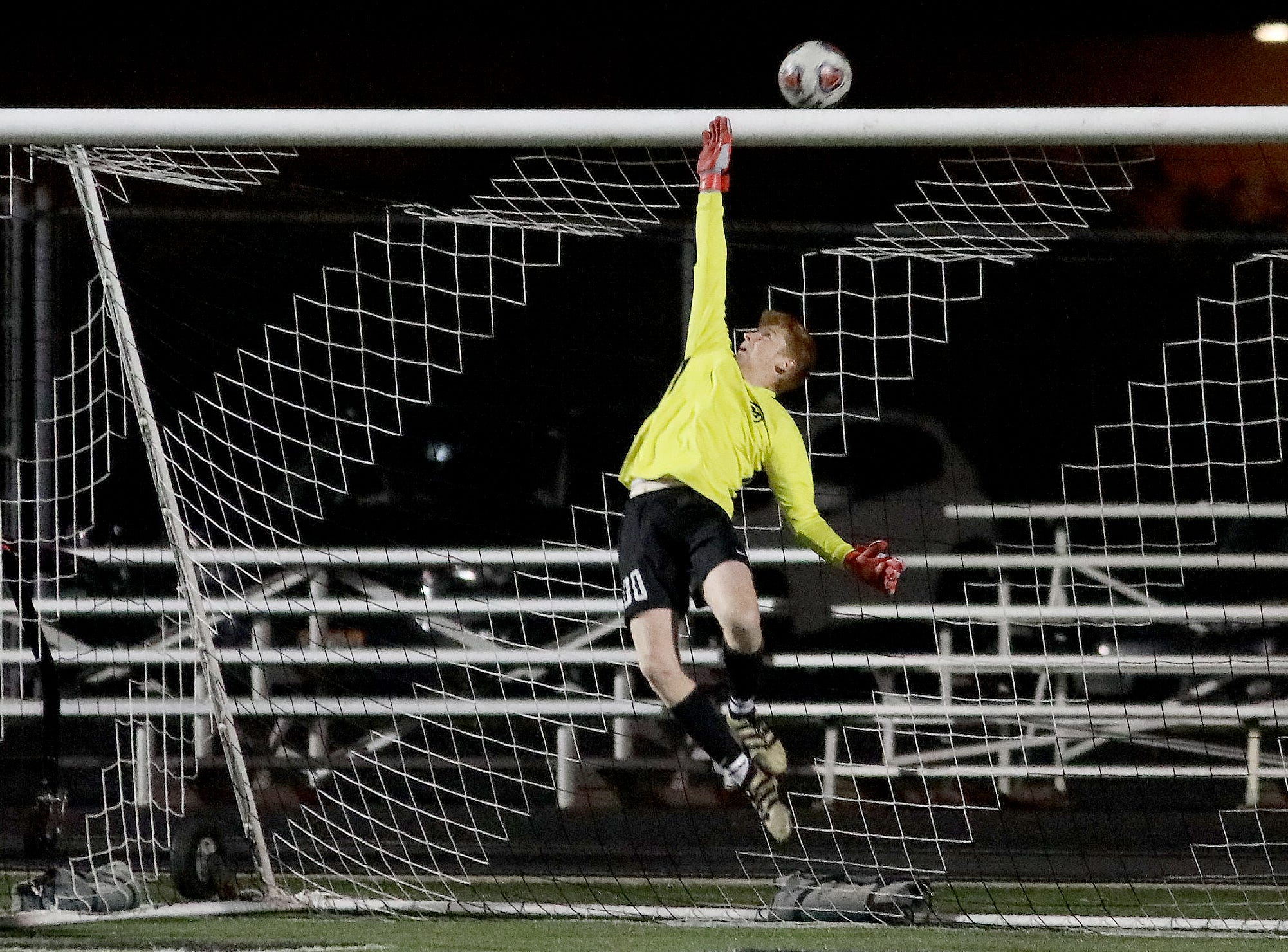 Moeller  goalie Brandon Cusmano stops a shot during their 2-0 win over Mason in the district final.