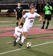Alex Hamilton (20) dribbles the ball past the midfield strike for Anderson, October 25, 2018
