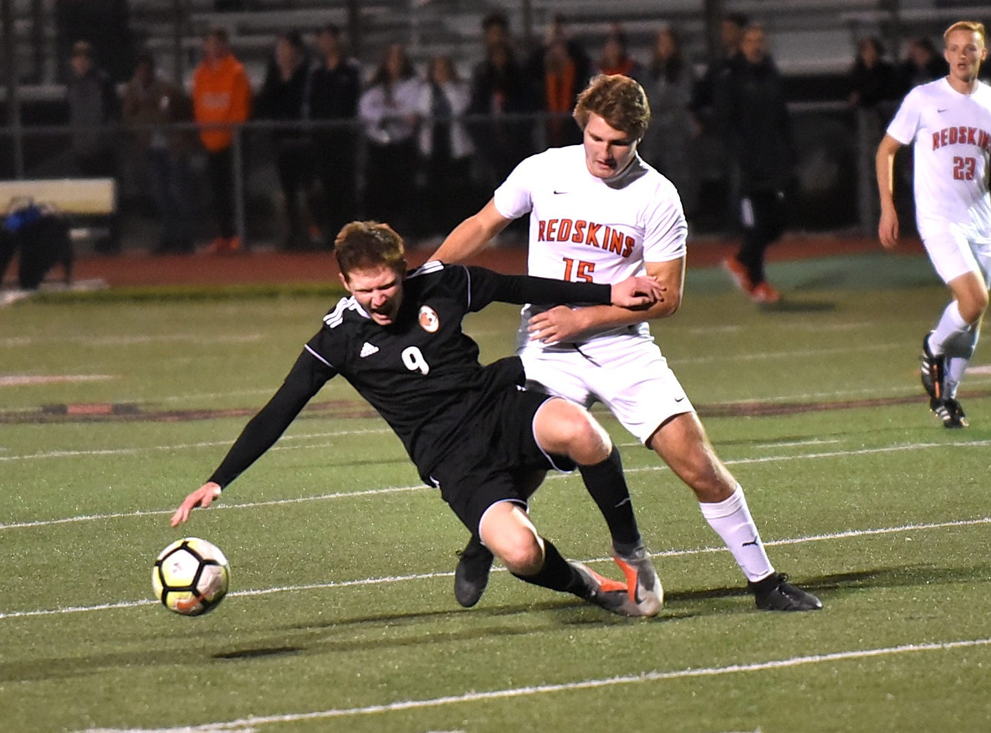 Billy Straub (15) of Anderson battles Beavercreek for ball control, October 25, 2018.