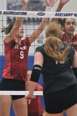St. Henry senior Bridget Bessler, left, and freshman Taylor Preston go for the block during St. Henry's 3-0 sweep of North Oldham in the first round of the KHSAA state volleyball tournament Oct. 26, 2018 at Valley High School, Louisville, KY.