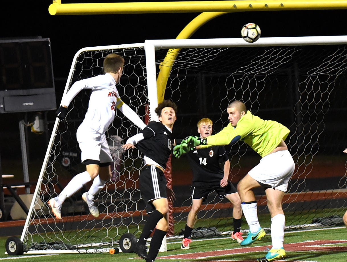 Anderson's Jason Moore watches his header shot sail into the goal giving the Redskins a 2-1 overtime win in the SWDAB District Boys Soccer Championship, October 25, 2018.