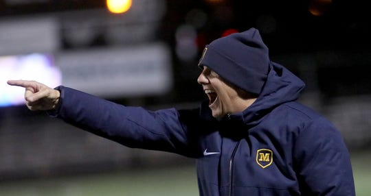 Moeller  head coach Mike Welker reacts during their 2-0 win over Mason in the district final.