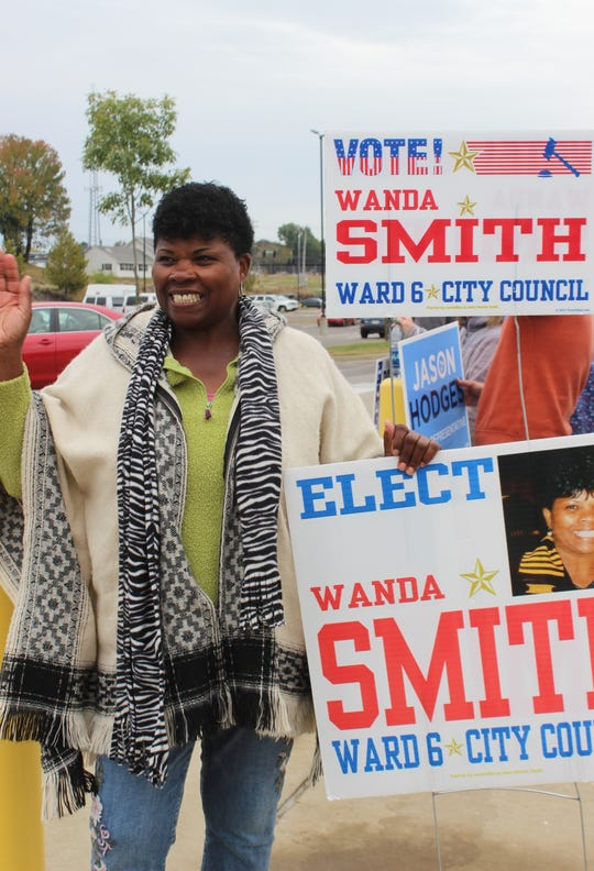 City councilwoman Wanda Smith greets voters with a wave and a smile outside the Montgomery County Election Commission office