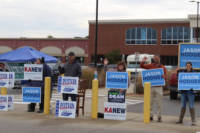 Democratic candidate for State House District 67 Jason Hodges and supporters greet voters headed out for early voting on Thursday in Montgomery County.