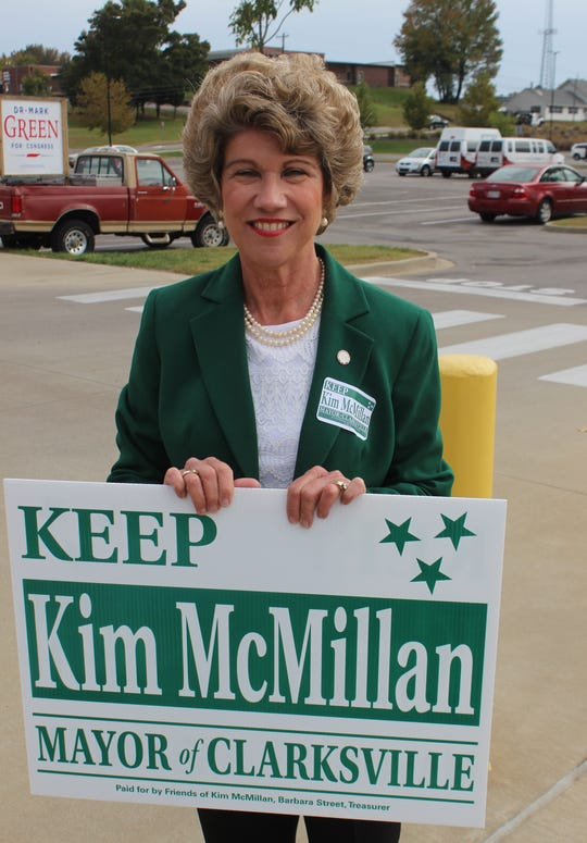 Mayor Kim McMillan greets voters headed in to vote on Thursday.