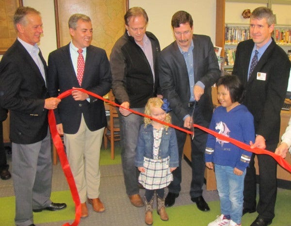 Hunterdon County freeholders John W. King, John E. Lanza, and Matt Holt join East Amwell Mayor Tim Mathews and Hunterdon County Library Director James Keehbler and East Amwell school children to cut the ribbon on the county's new library branch in Ringoes.