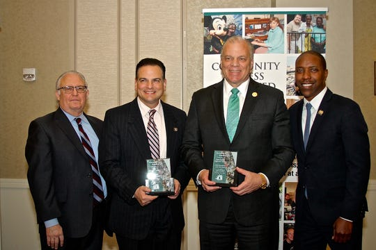 Senate President Stephen Sweeney and Senate Majority Leader Nicholas Scutari (center, right, and center, left, respectively) recently were honored at the Annual Gala Dinner Dance of the nonprofit Community Access Unlimited (CAU). They are flanked by CAU executive director Sid Blanchard (left) and Assemblyman Jamel Holley.